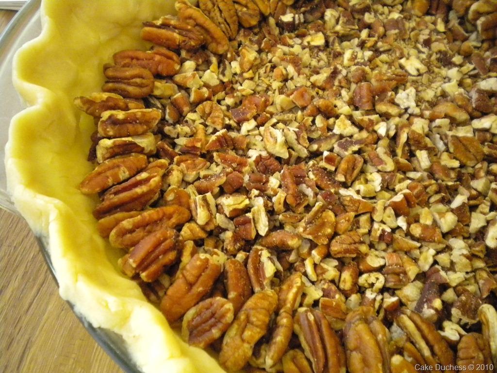 overhead image of pecans in a pie crust
