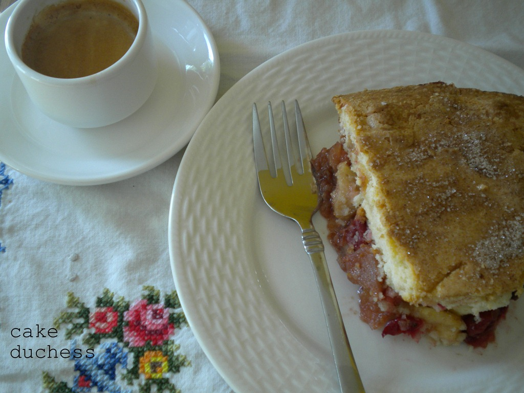 image of cake slice and coffee in a white cup