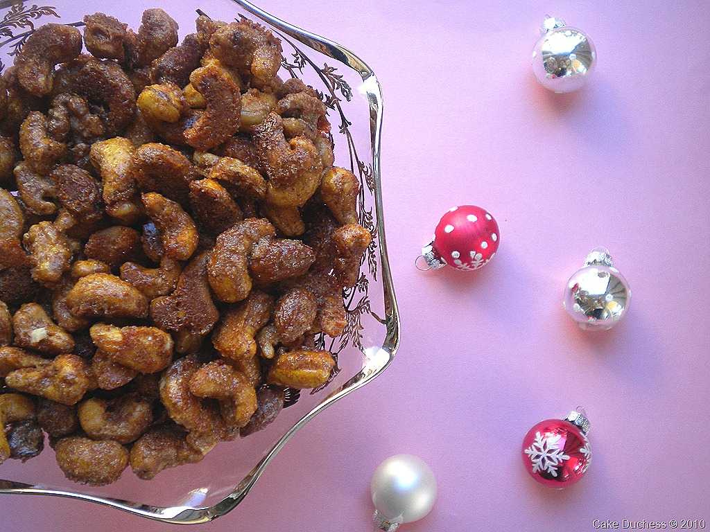 overhead image of nuts in a bowl on pink background