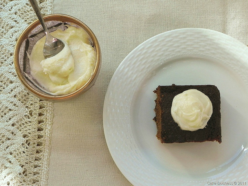overhead image of cake on plate and cream in a bowl