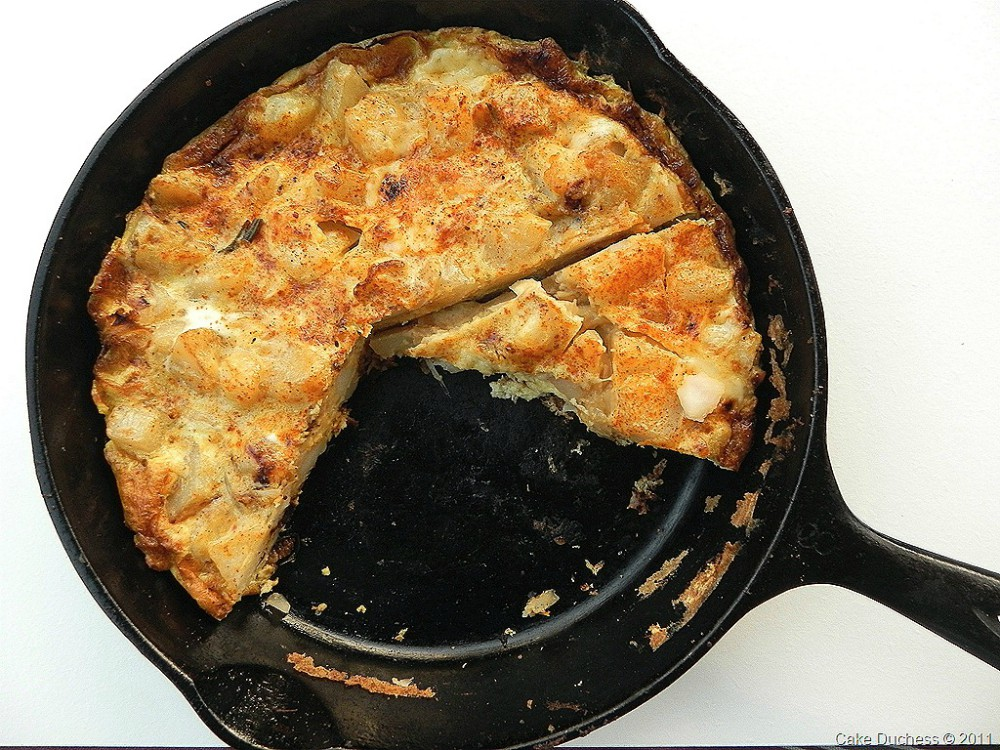 overhead image of egg and potato dish in cast iron skillet