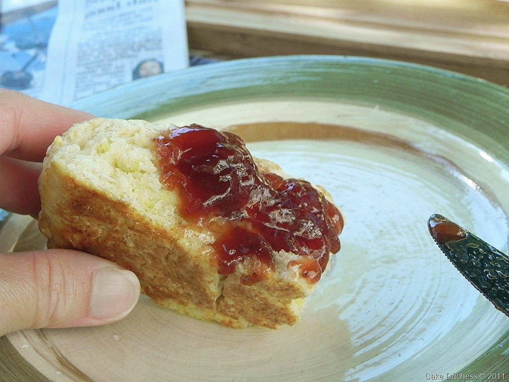 overhead image of scone with strawberry jam