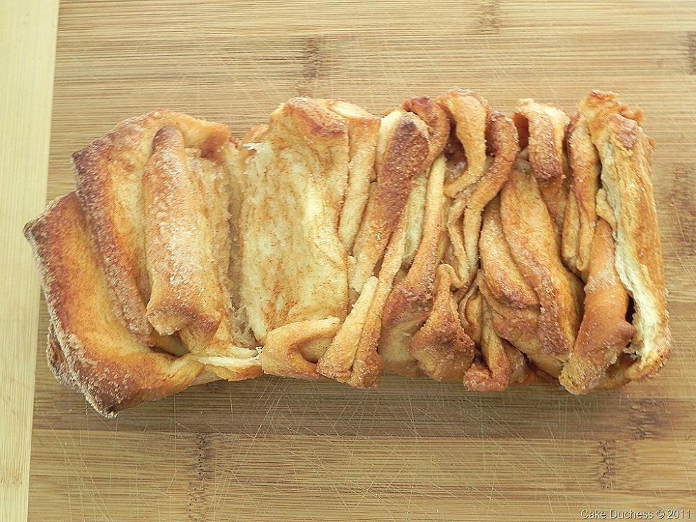 overhead image of pull apart bread on wood surface