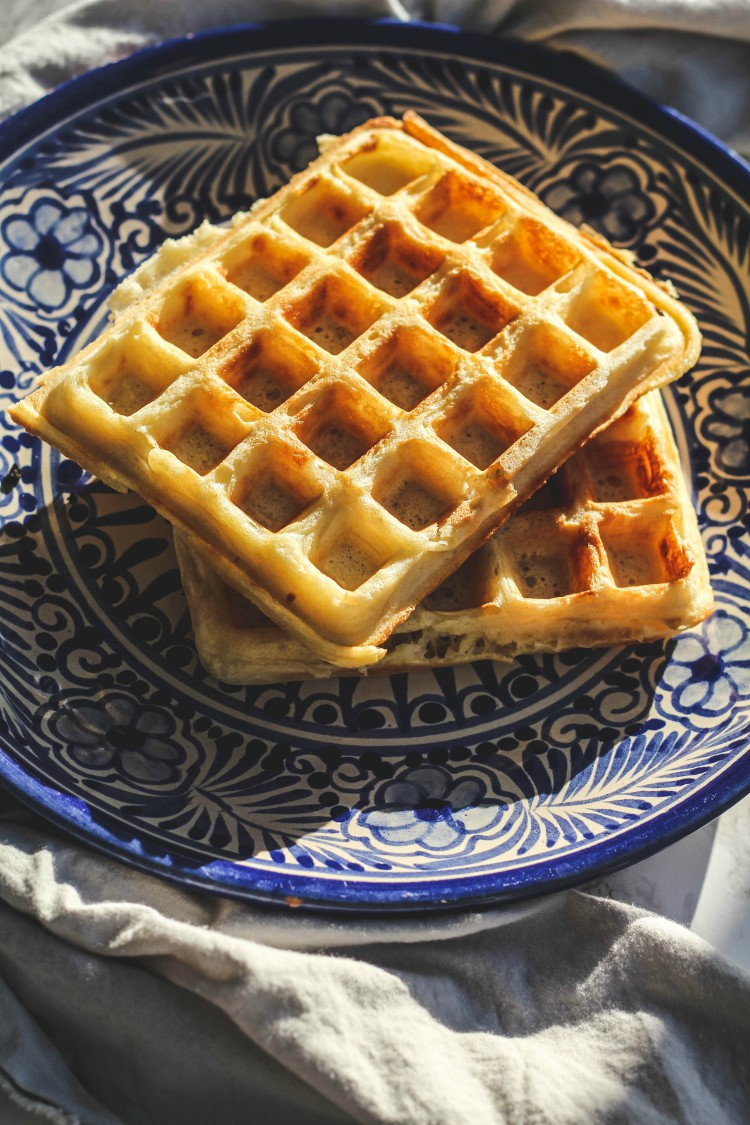 overhead image of marion cunningham's raised waffles on a blue plate