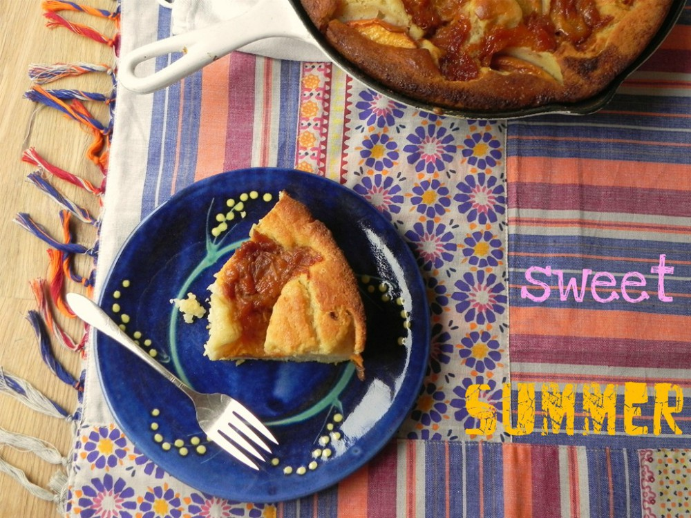 overhead image of peach dessert on blue plate