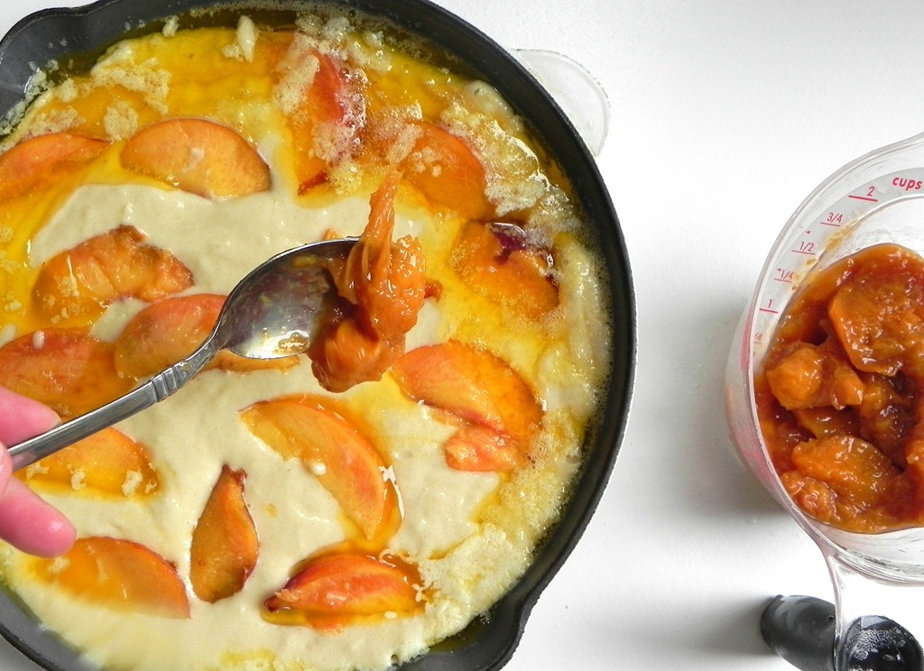 overhead image of peach dessert in a skillet