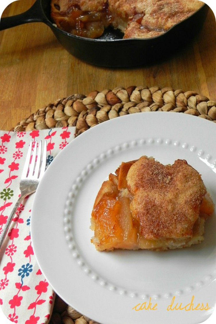 overhead image of apple cake on white plate