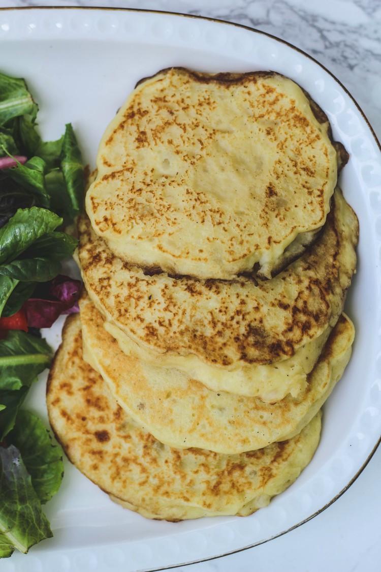 overhead image of potato pancakes with side salad