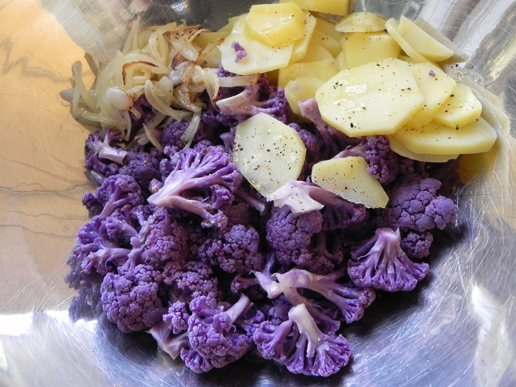overhead image of purple cauliflower onions and potatoes