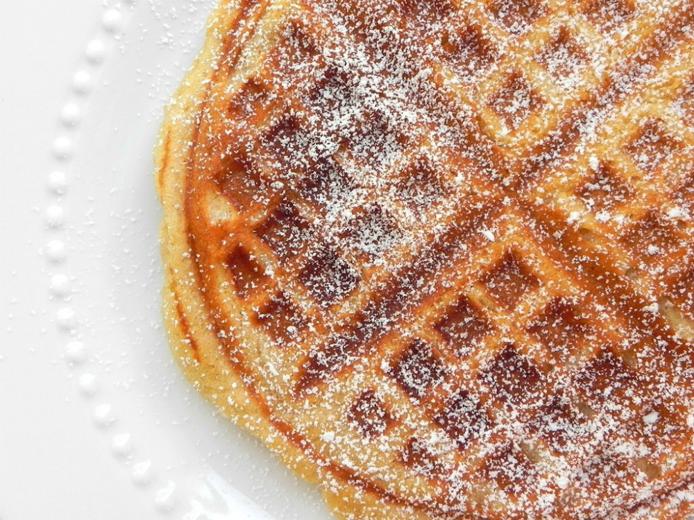 overhead image of overnight yeast waffle on a white plate