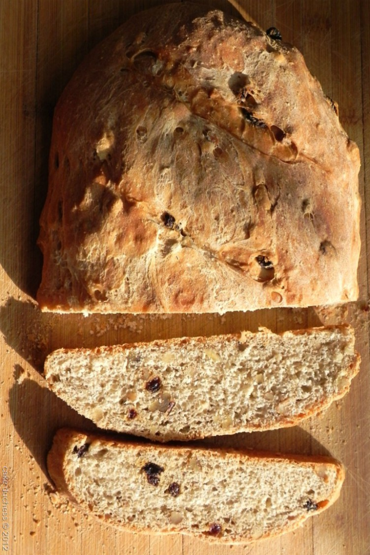 overhead image of rustic raisin walnut bread