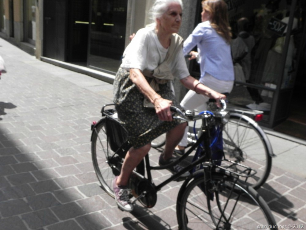 image of woman on a bike