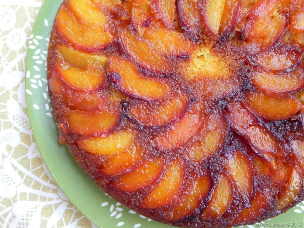 overhead image of peach and cornmeal upside-down cake
