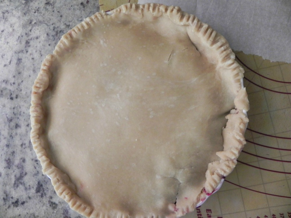 overhead image of pie ready to bake