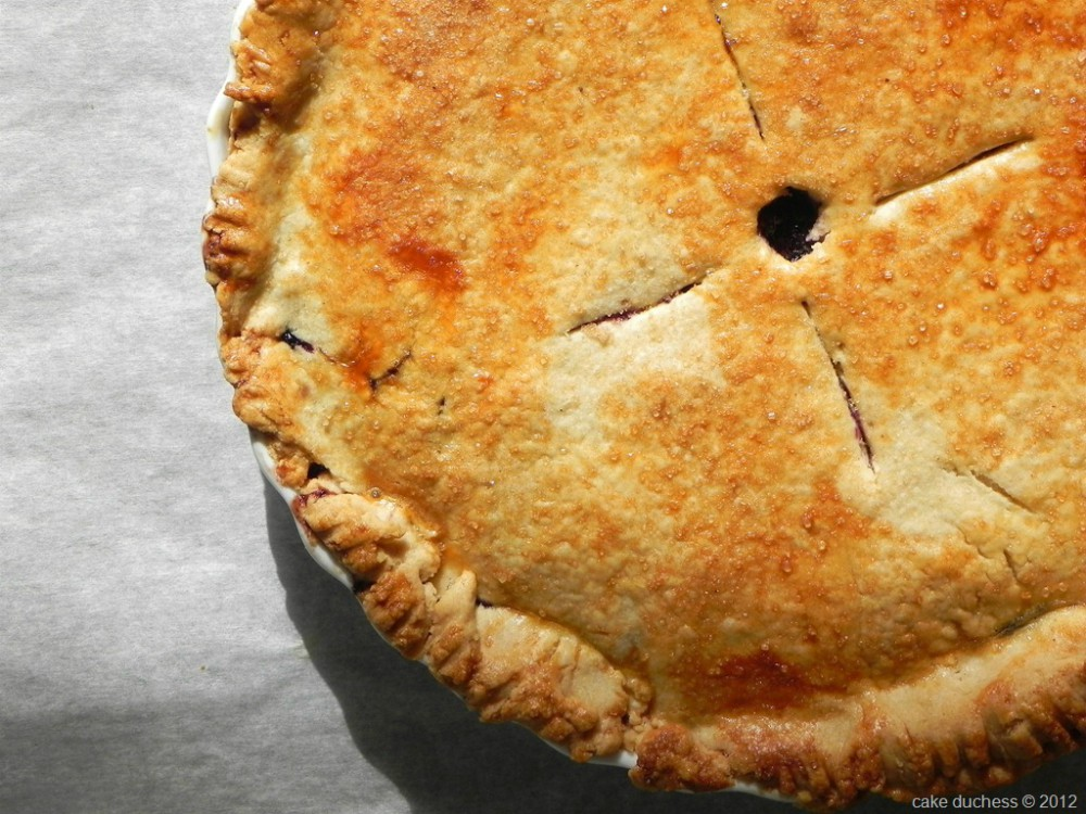 overhead image of a pie on parchment paper sheet