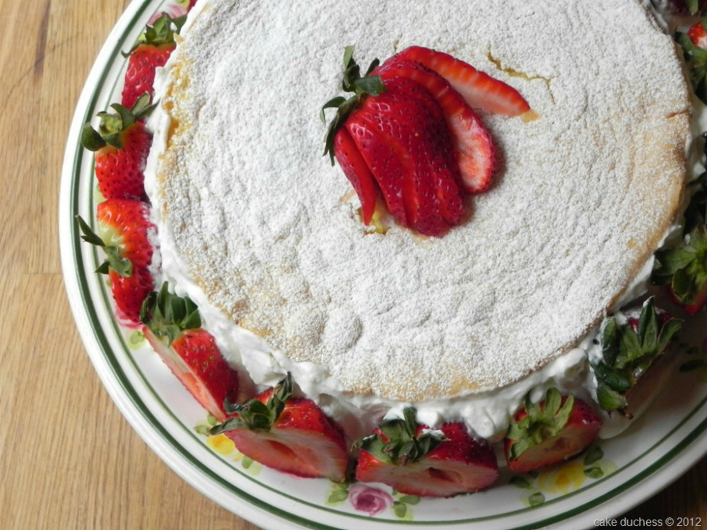 overhead image of summer strawberry cake