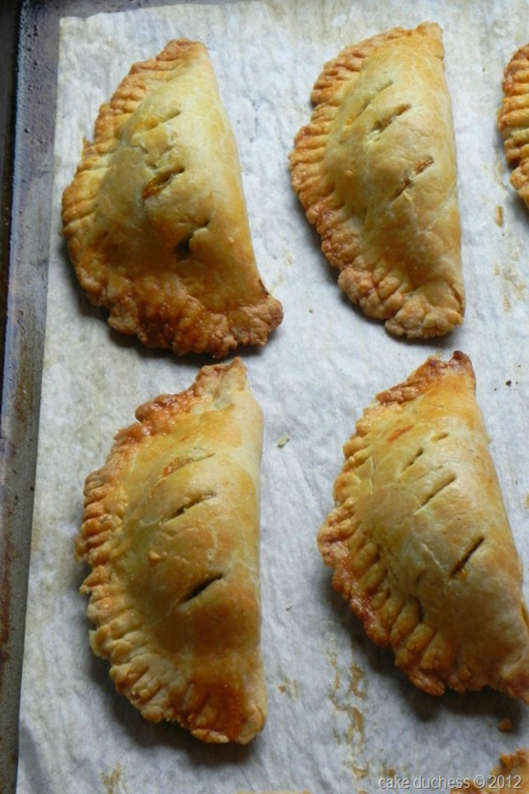 overhead image of empanadas on baking tray