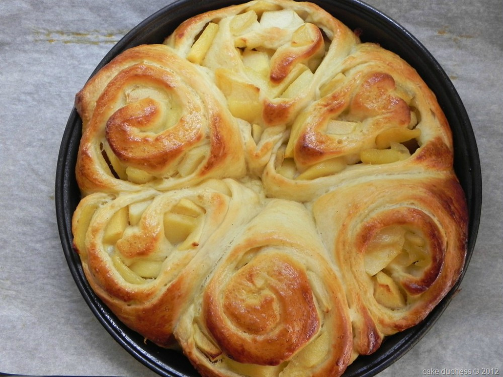 overhead image of 6 apple bread rings just baked without icing