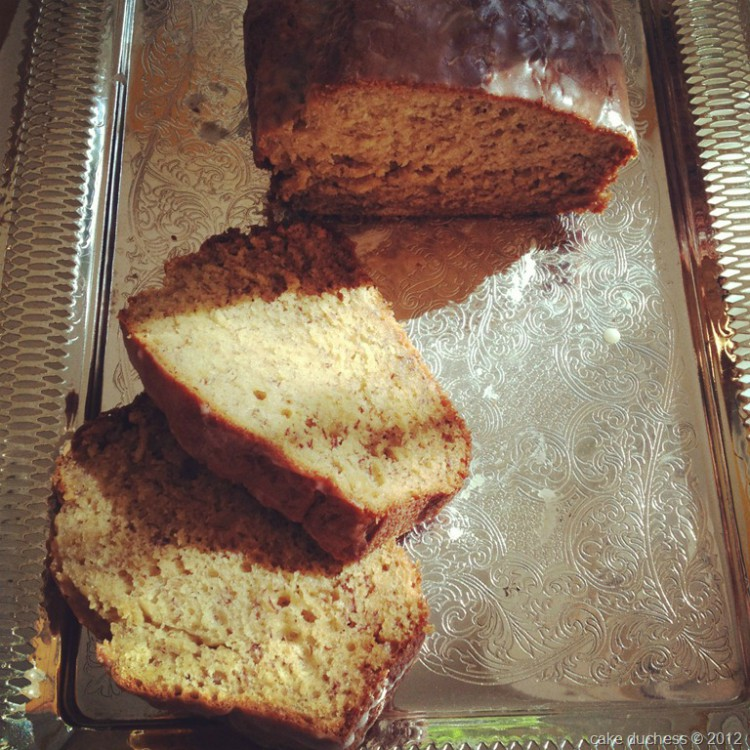 overhead image of banana bread sliced on a silver tray