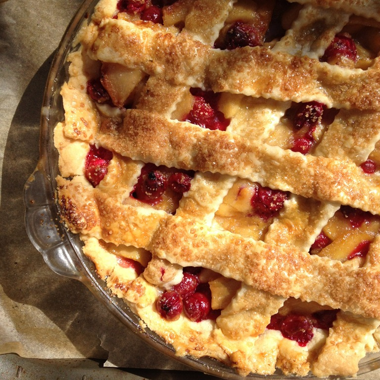 overhead image of cranberry apple pie on parchment paper