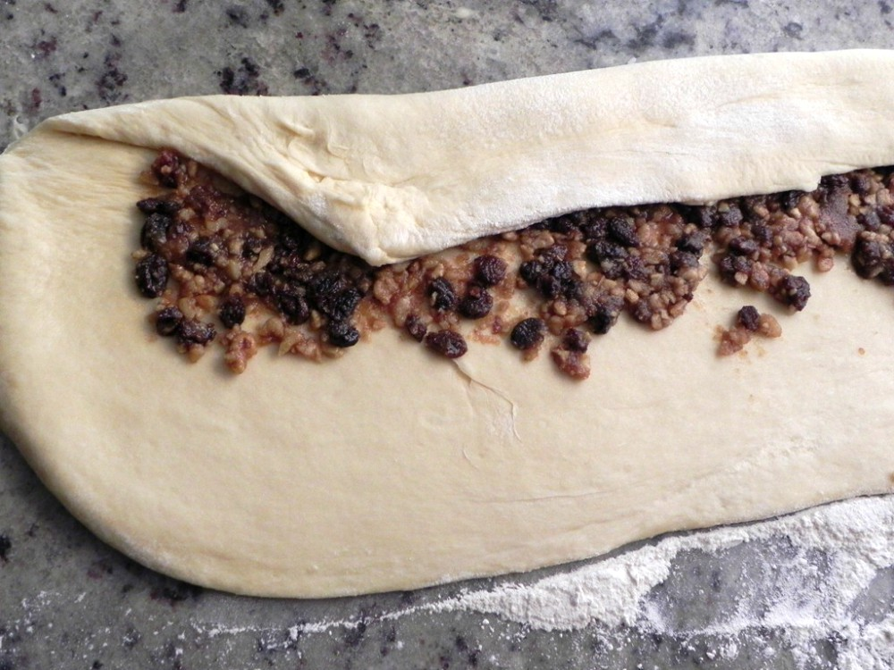 overhead image of dough with nut and raisin filling