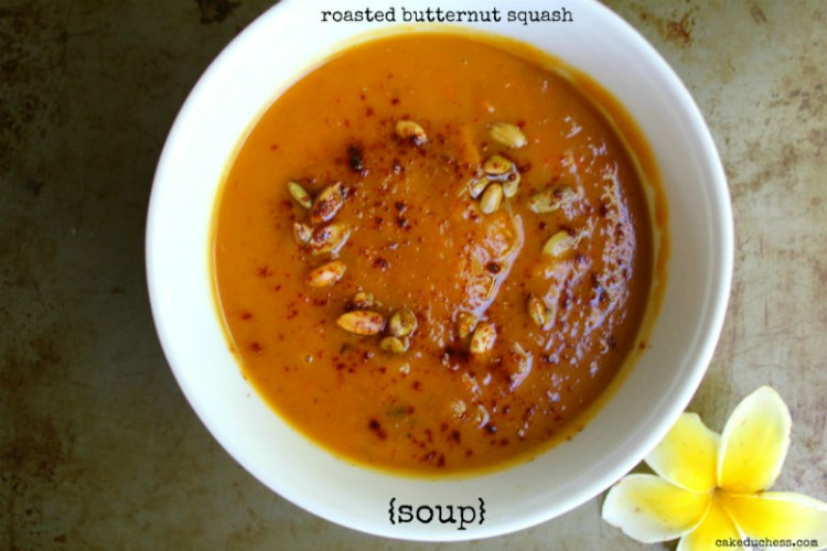 overhead image of roasted butternut squash soup on a metal background