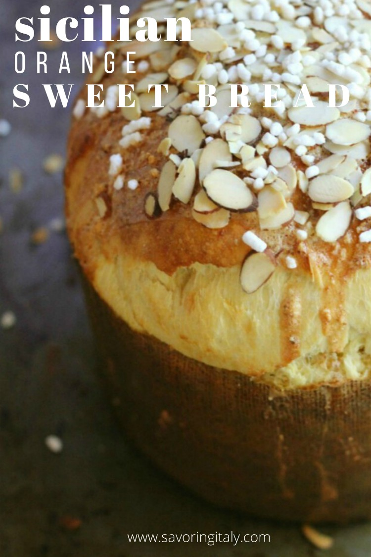 overhead image of round loaf of bread with almond slices and sugar on top
