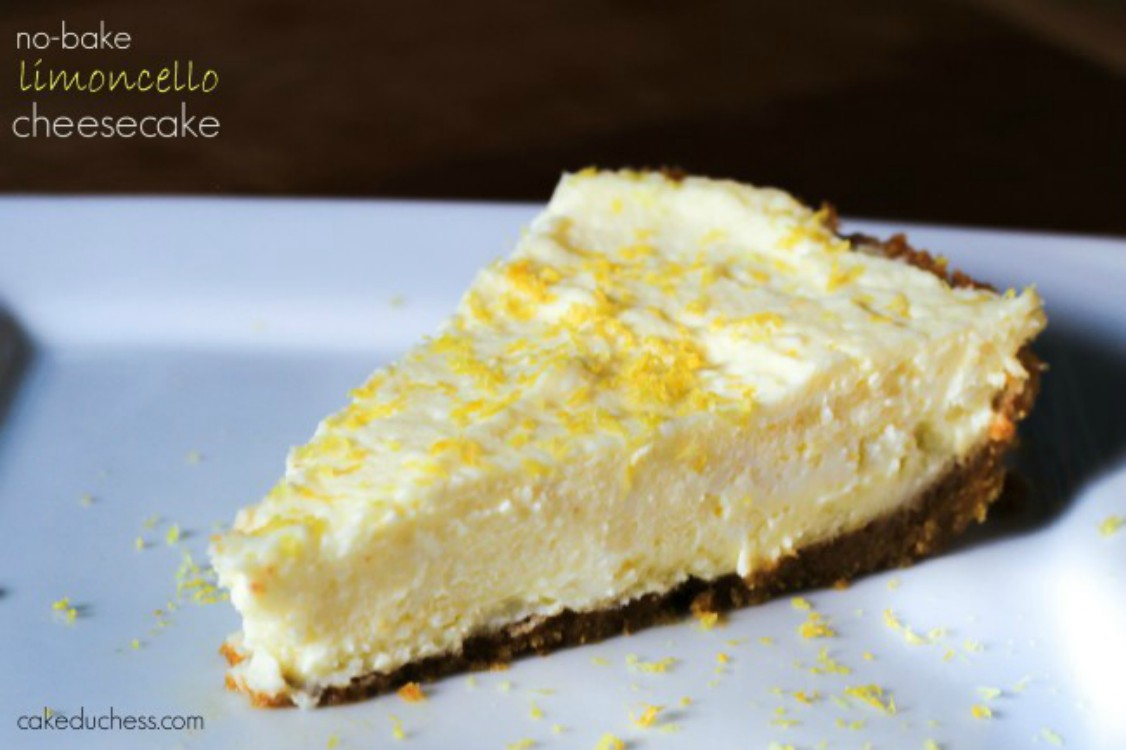 overhead image of slice of lemon cheesecake on white plate