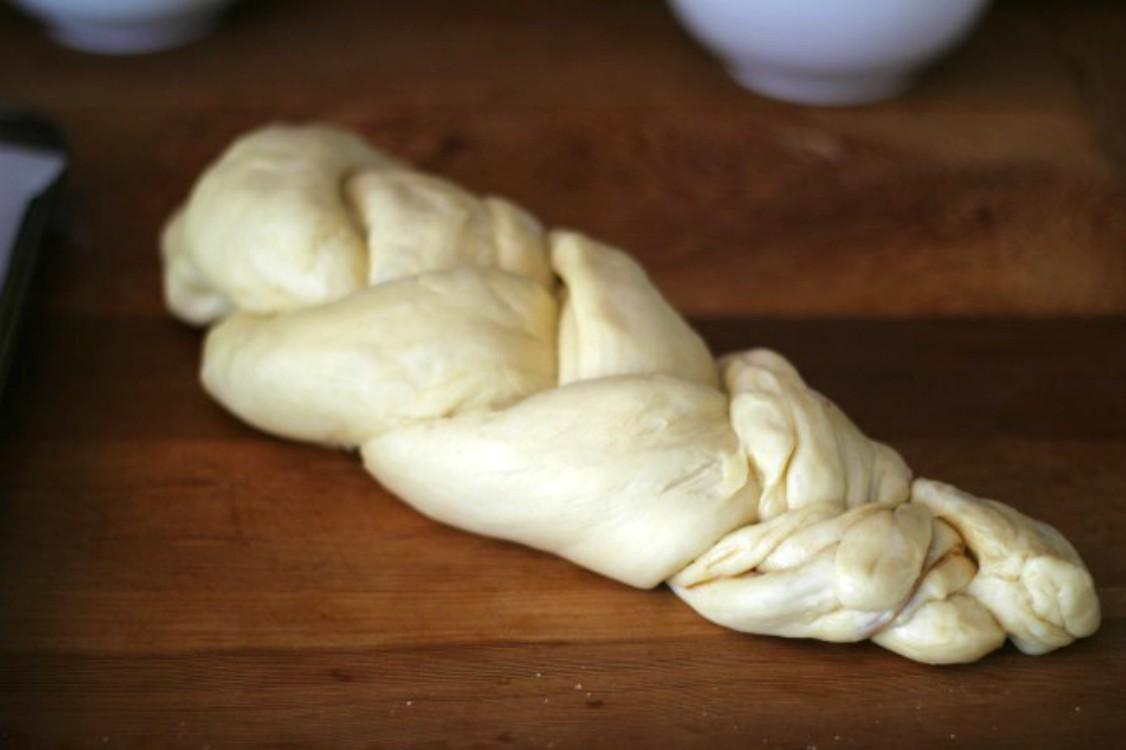 overhead image of challah braided loaf before baking