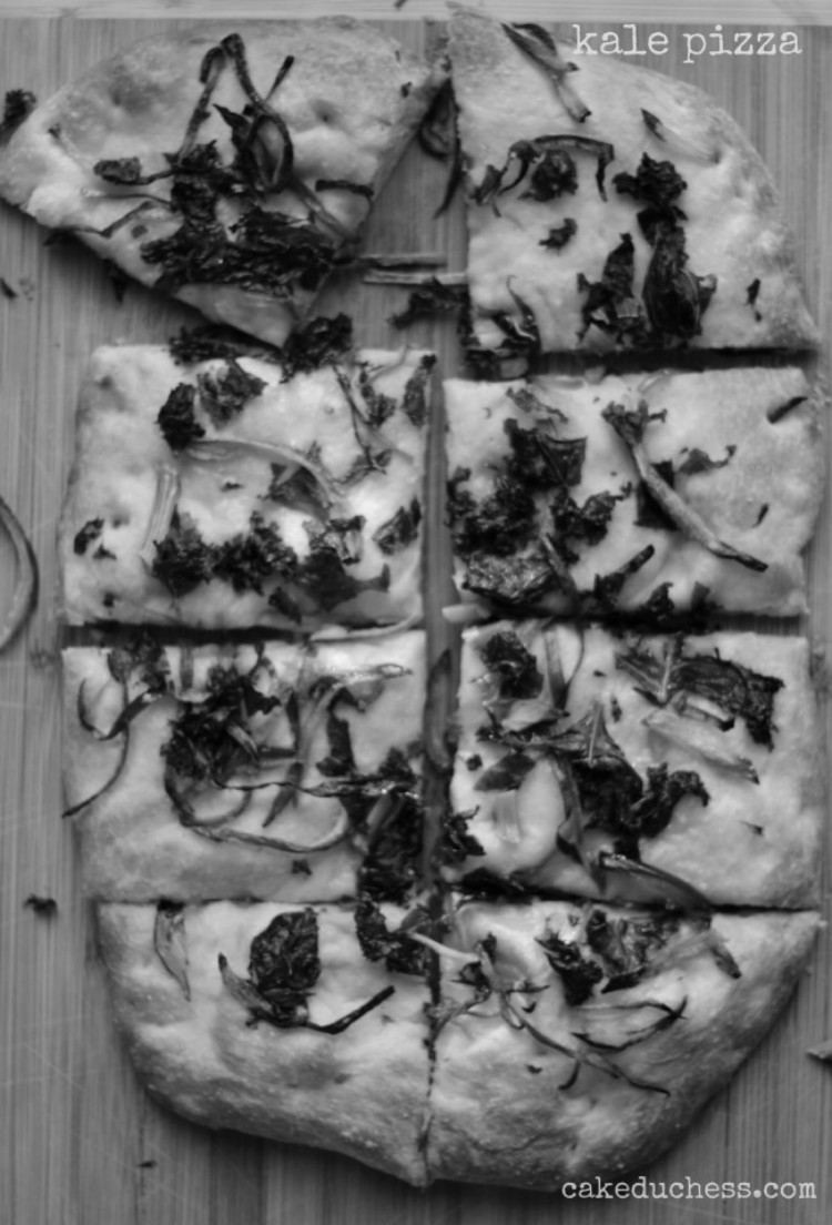 overhead image of kale pizza