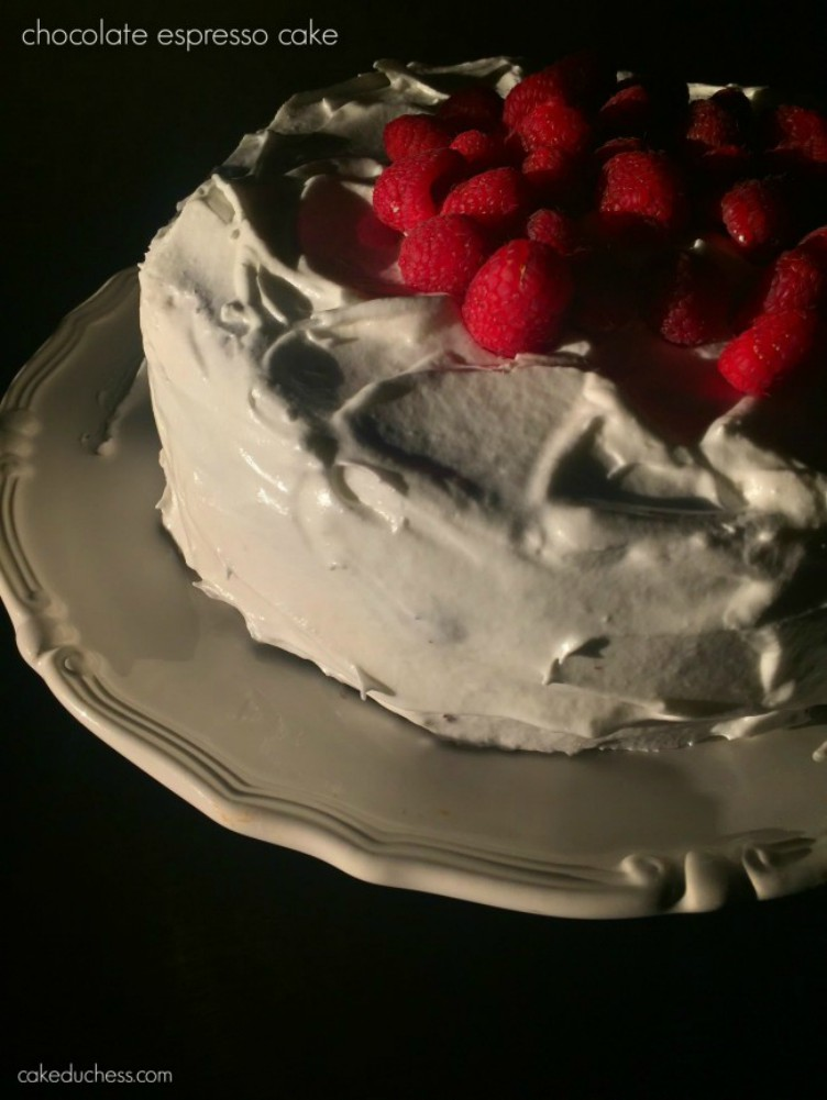 overhead image of cake with white frosting and berries on top