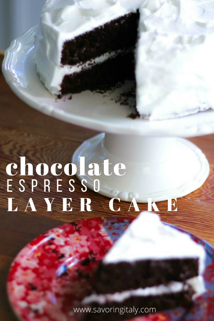 image of a chocolate espresso layer cake on a white cake plate