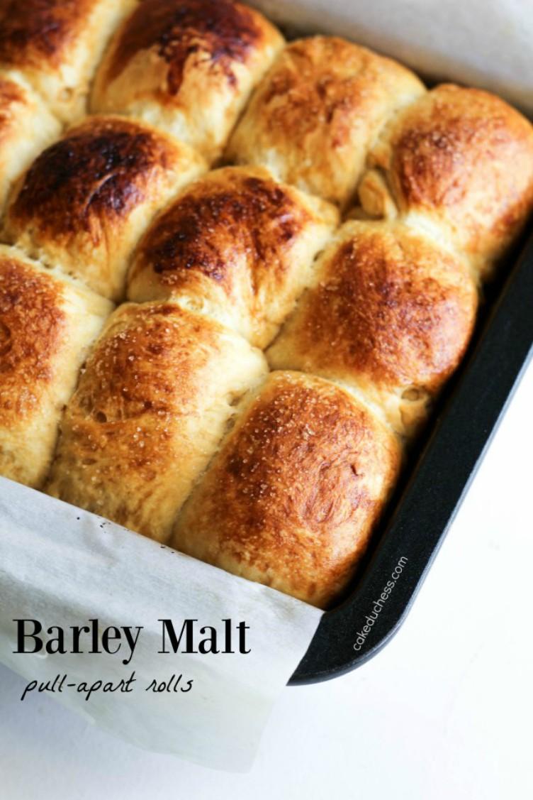 overhead imge of barley malt pull-apart loaves in baking tray