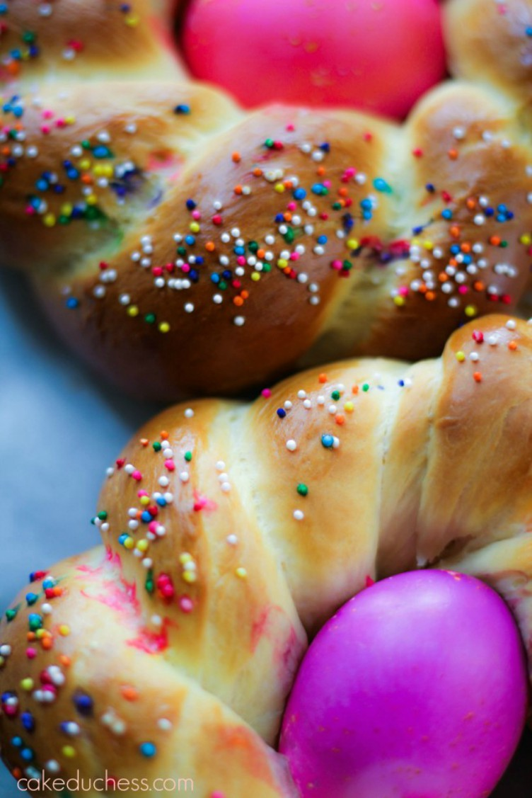 overhead image of colored eggs in braided bread