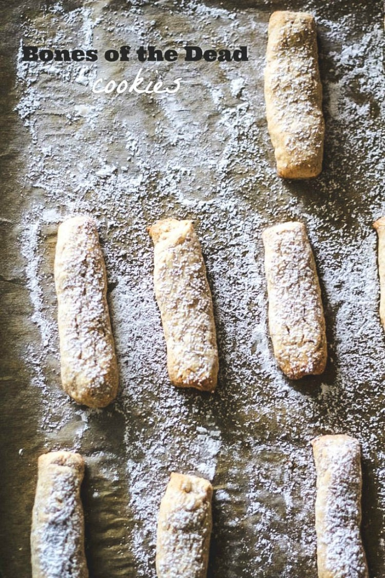 Overhead image of 7 Bones of the Dead Cookies-Ossa di Morto Italian cookies on parchment paper.