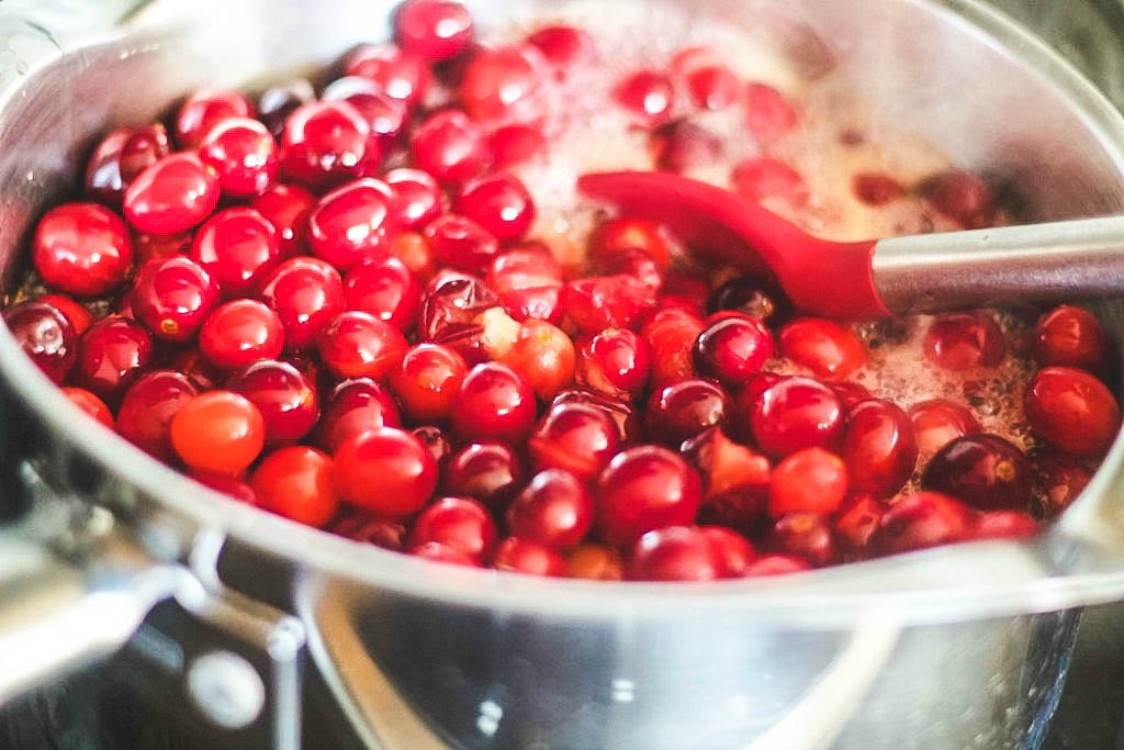 cranberries cooking in a large sauce pan