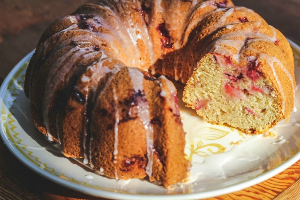 fresh strawberry bundt cake with slice missing on plate