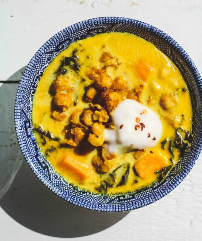 Chickpea Stew with Kale and Sweet Potatoes is a delicious vegan stew to enjoy all winter long. It's packed with chickpeas, sweet potatoes, kale and creamy coconut milk. Enjoy with your favorite flat bread and you have a perfect dinner! #vegan #thestew #chickpeas #soup #dinner #vegetarian