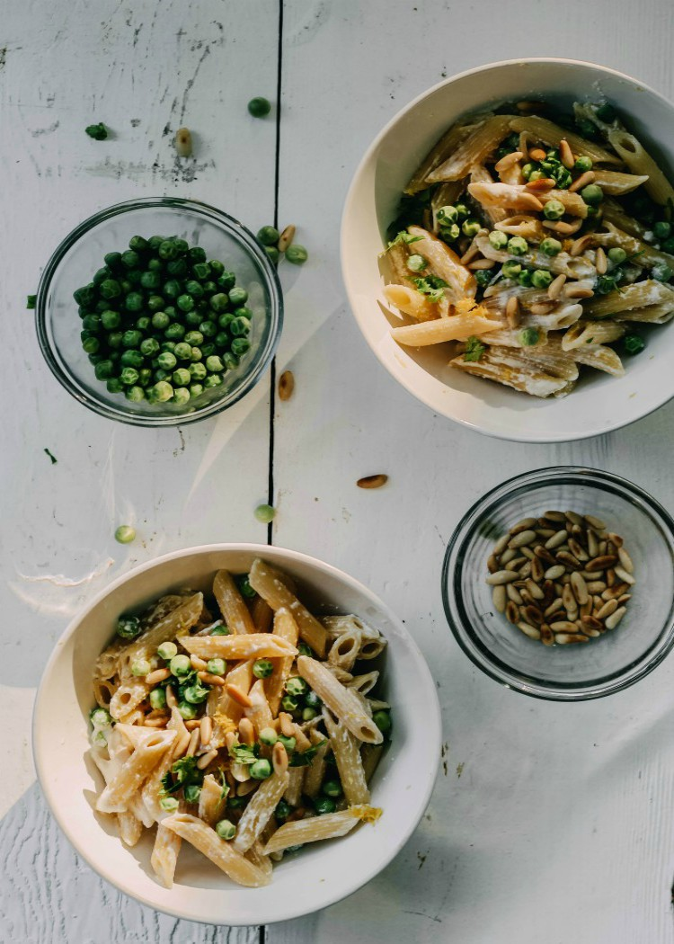 overhead image of pasta with ricotta and peas