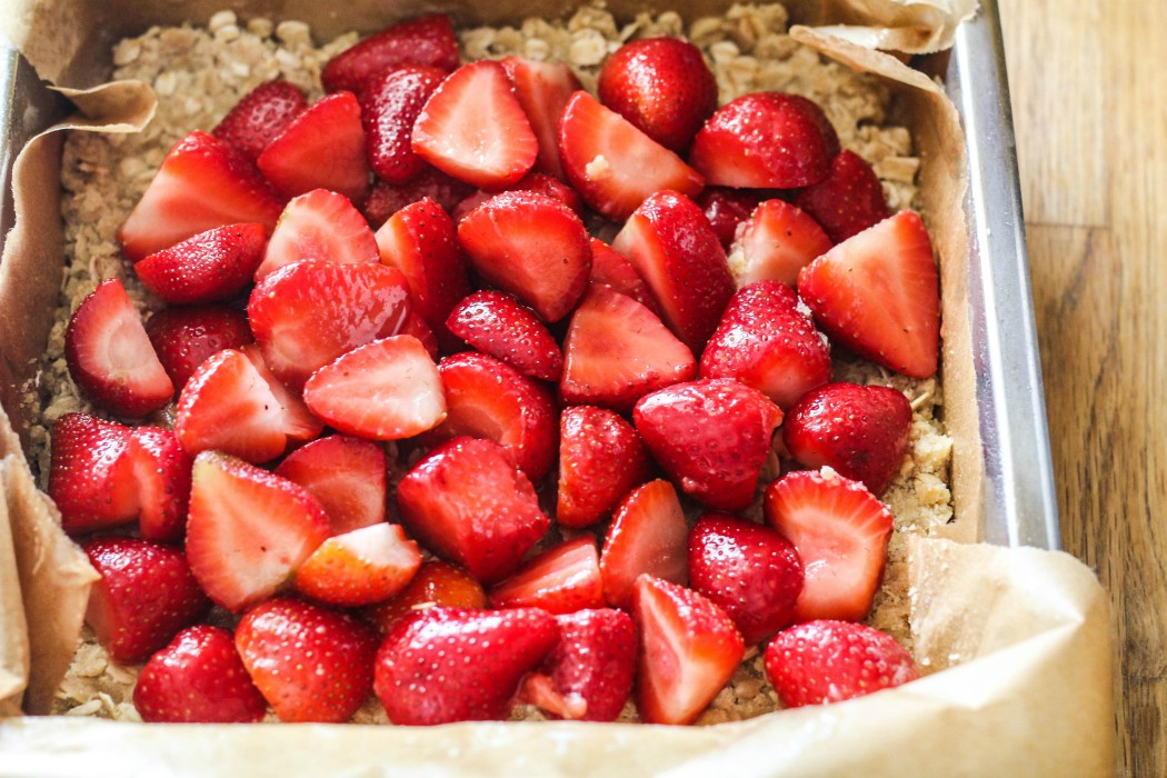 overhead image of strawberries in an oat crust
