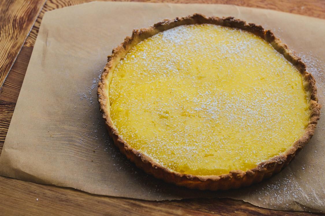 lemon curd tart on parchment paper