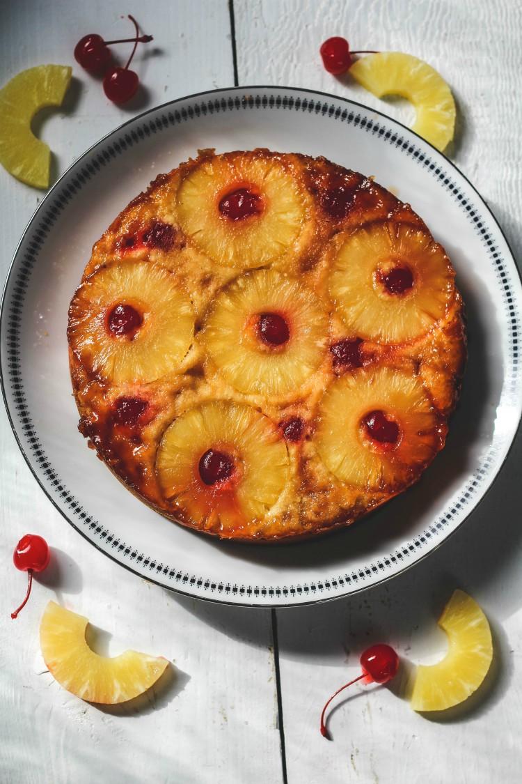 vegan pineapple upside down cake on white plate