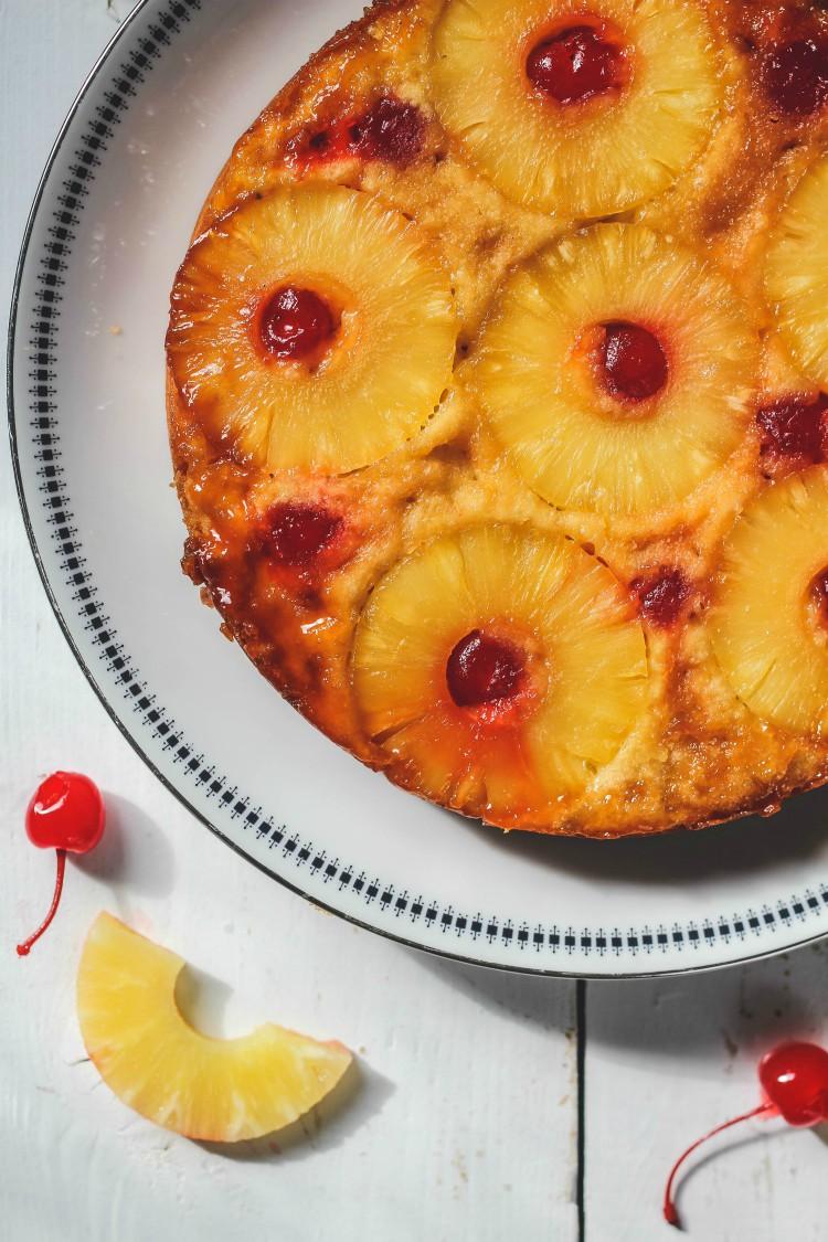 homemade pineapple upside down cake on white plate