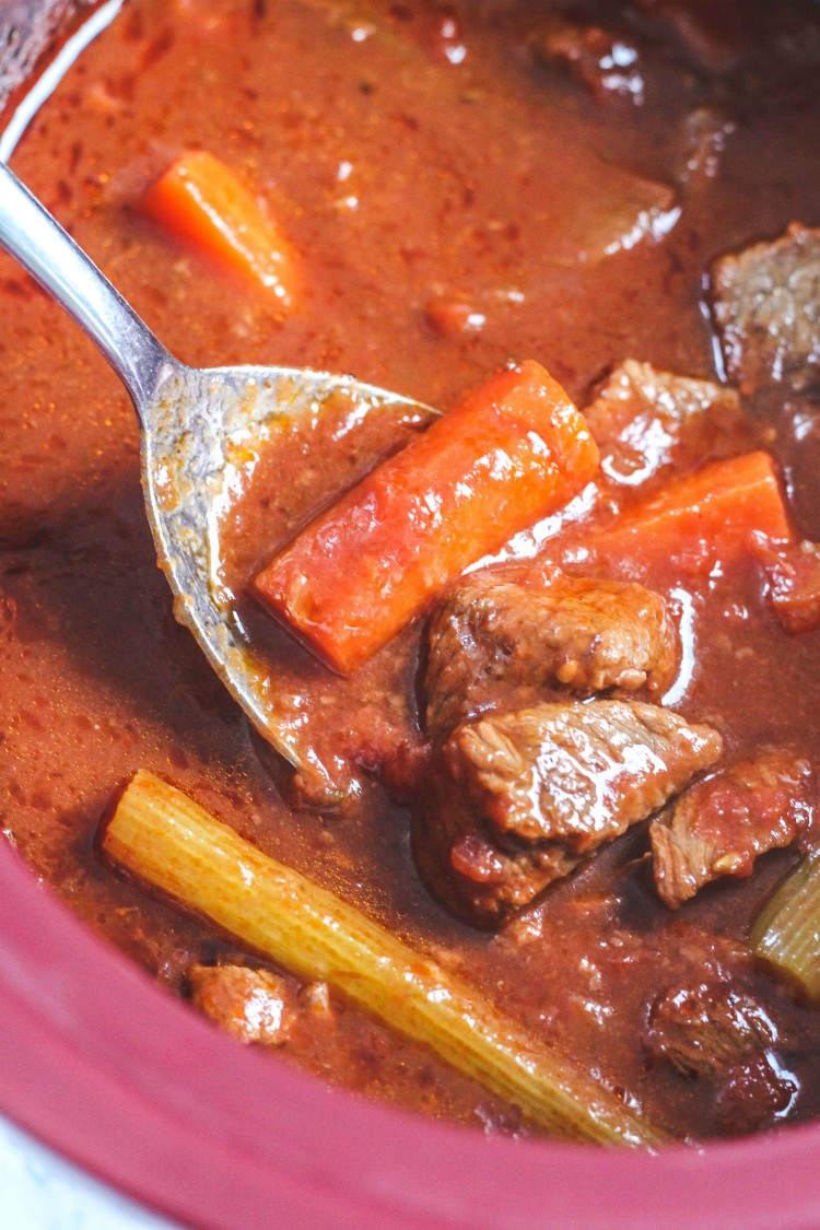 overhead image of Italian beef stew in red pot