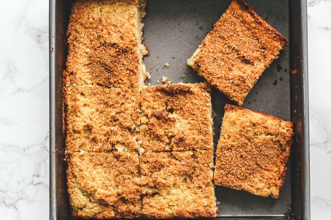 overhead image of banana cake sliced in pieces