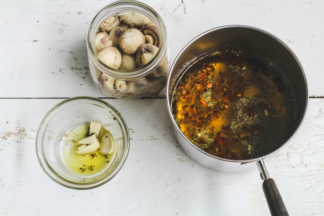 overhead image of making marinated mushrooms