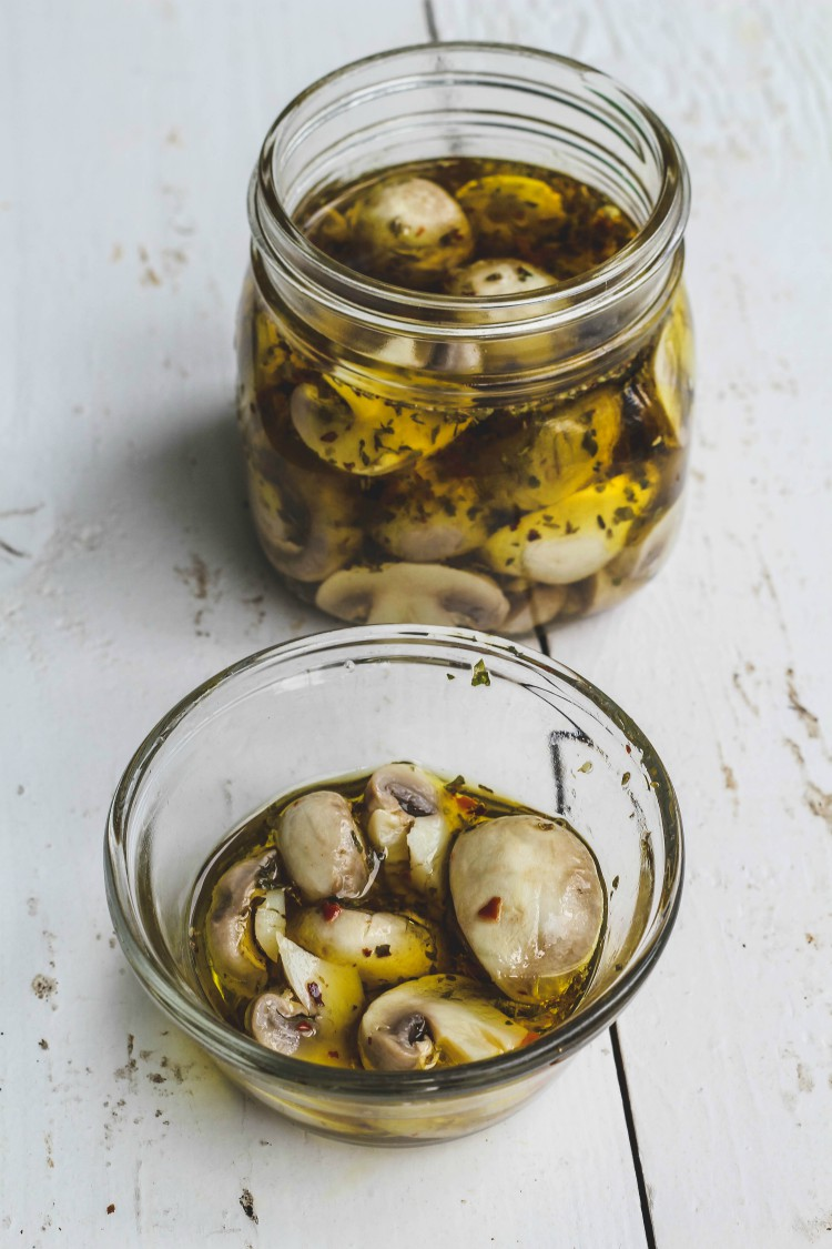 overhead image of easy marinated mushrooms in glass jars