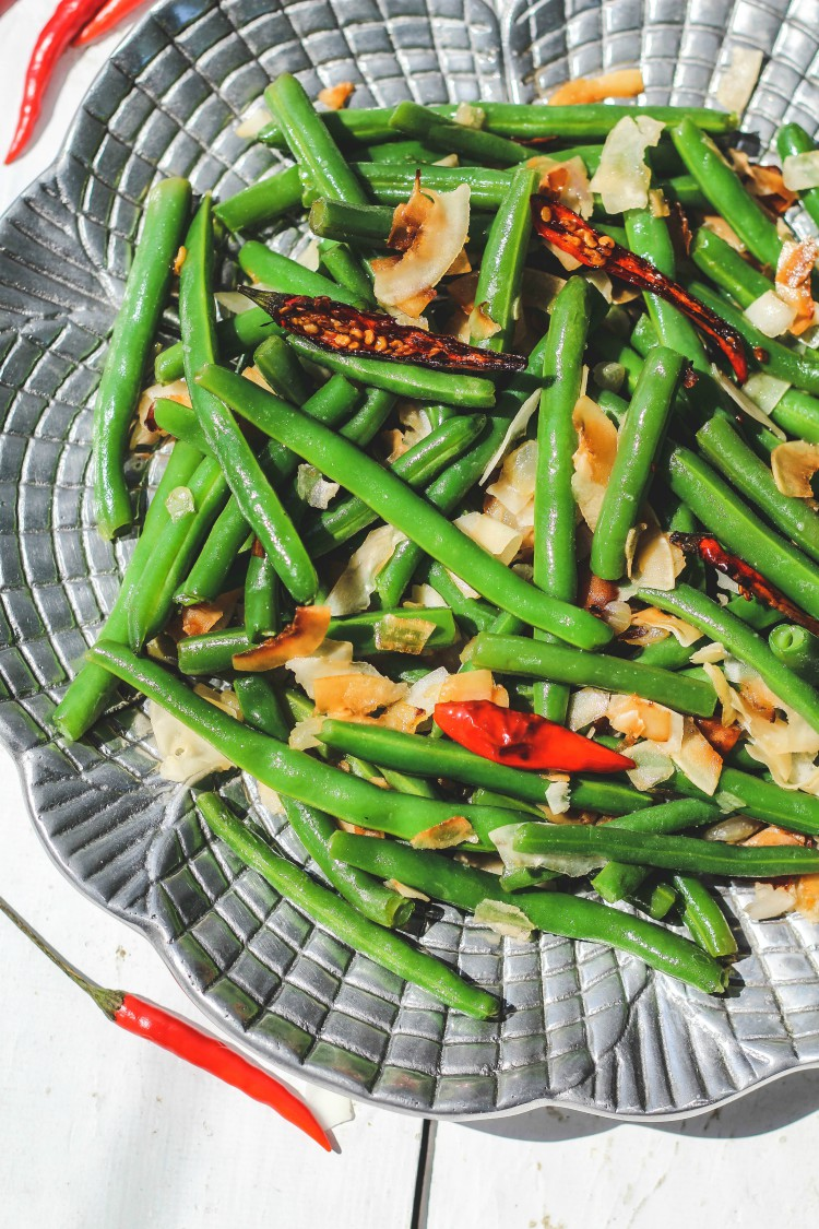 overhead image of caramelized coconut green beans