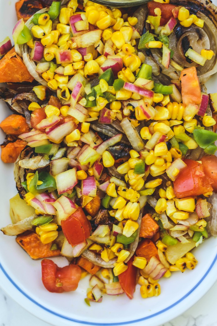 overhead image of roasted potatoes and sweet corn relish