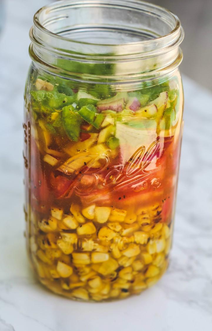 overhead image of sweet corn relish in a jar